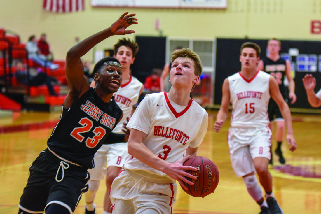 Bellefonte's Nate Tice (3)goes up for a layup as Jersey Shore's Junior Armstrong (23) tries to block the shot. (The Express/Tim Weight)