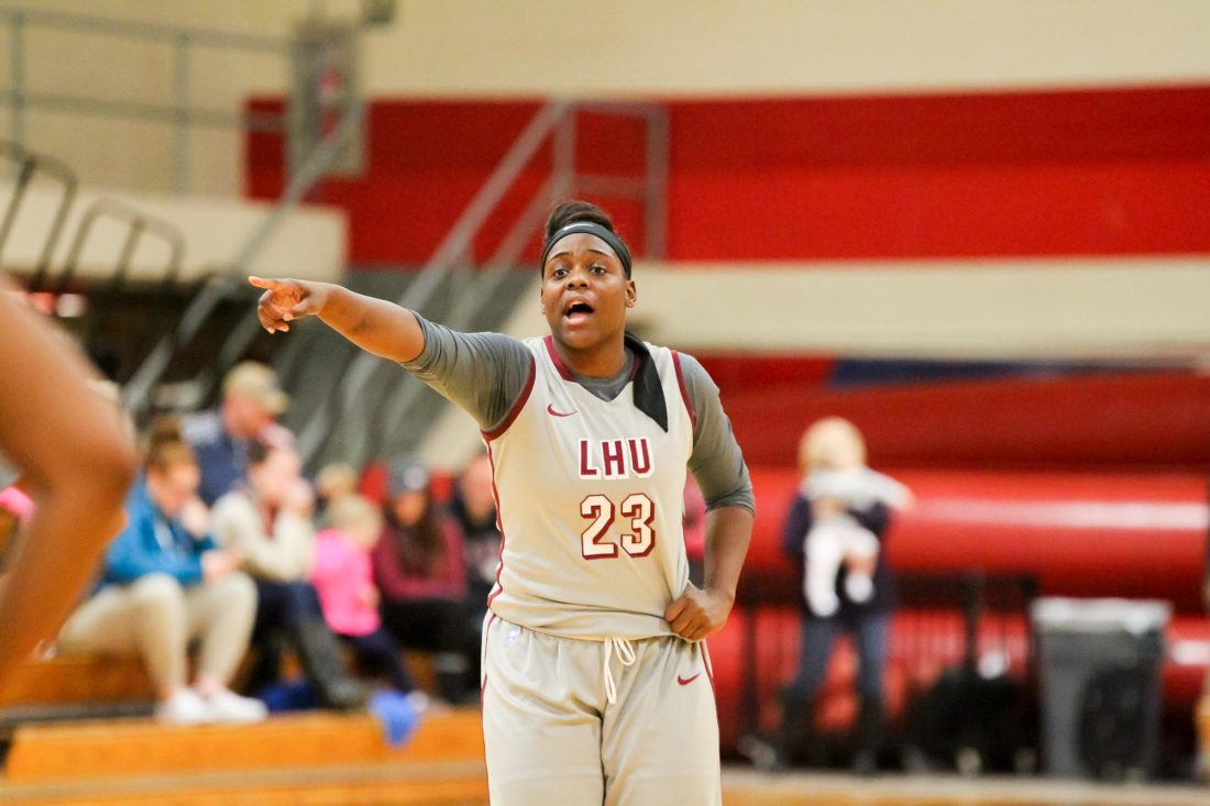 Senior guard Kayla Henderson (23) of Lock Haven University prepares the offense for a trip down the court. (Photo courtesy of LHU Women's Basketball)