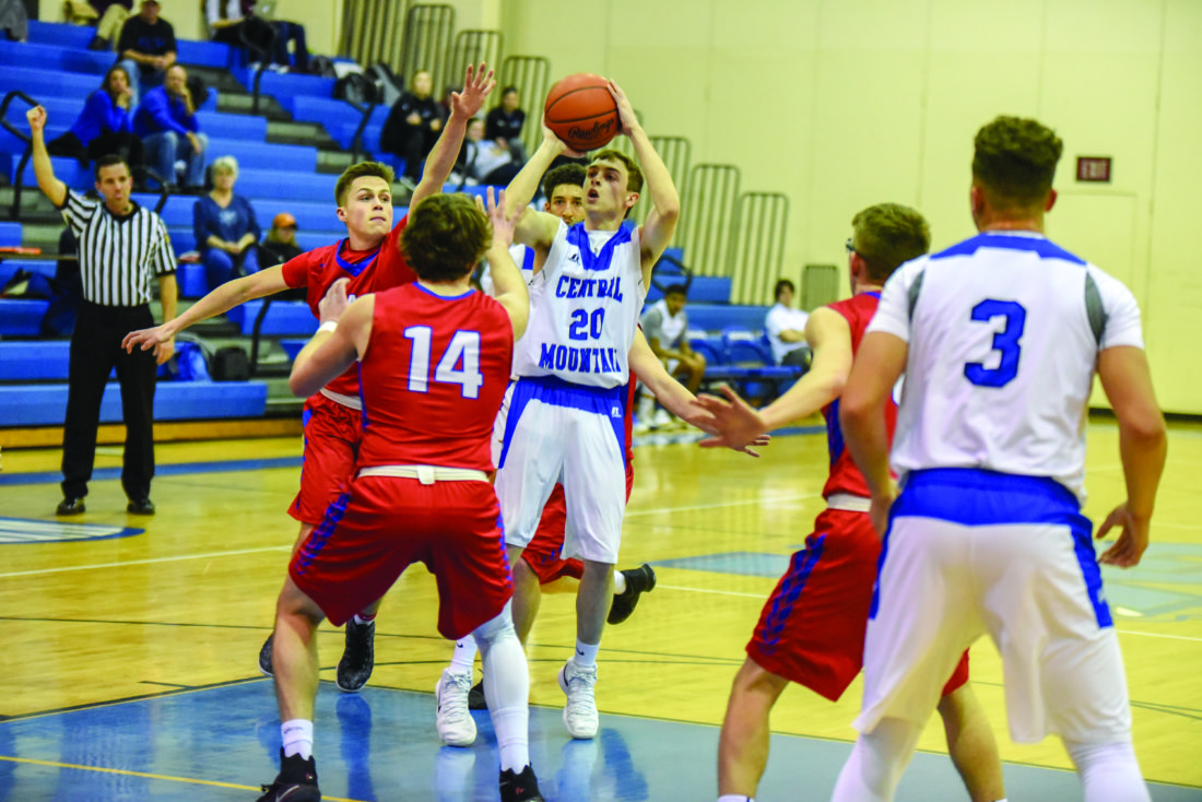 Central Mountain High School's Tanner Lavelle (20) shoots in the lane against Selinsgrove High School during high school boy's basketball action on Wednesday, January 31, 2018 in Mill Hall. The Wildcats won 64-53. (The Express/Tim Weight)