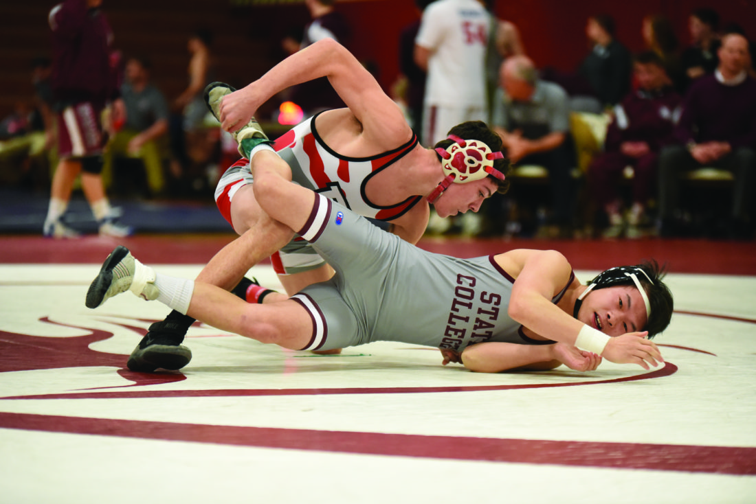 Bellefonte High School 126-pounder Cole Stewart wrestles his opponent from State College High School during high school wrestling action at Lock Haven University on February 1, 2018. The Red Raiders lost 36-33. (The Express/Tim Weight)
