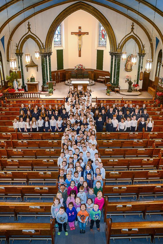 PHOTO PROVIDED Lock Haven Catholic student form a cross in the sanctuary at Immaculate Conception Church.