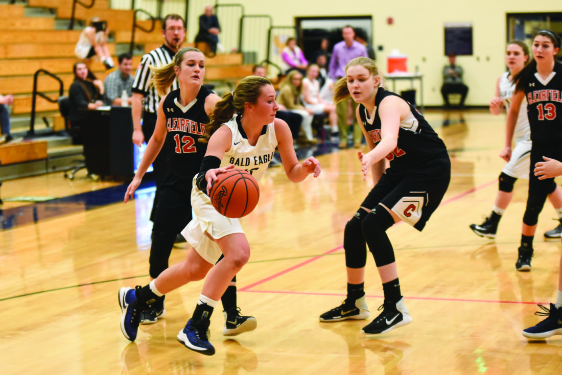 BEA's Lacee Barnhart dribbles toward the basket in Friday night's home contest against the Clearfield Bison.