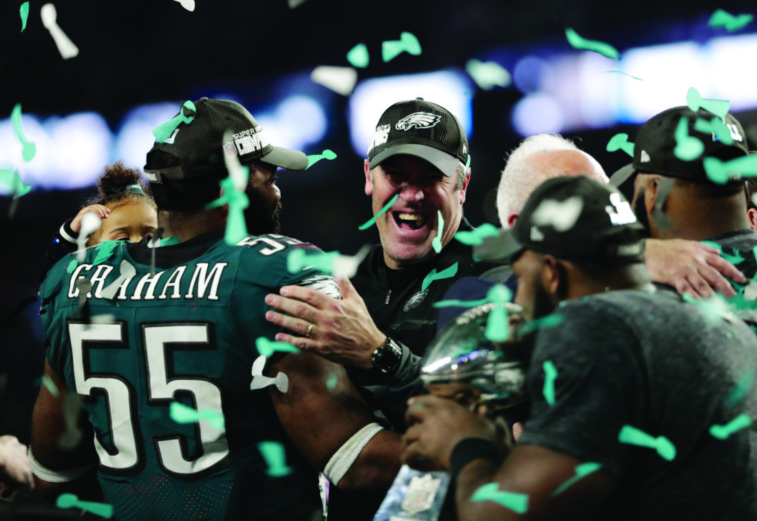 Philadelphia Eagles head coach Doug Pederson celebrates with defensive end Brandon Graham (55) and other players after winning the NFL Super Bowl 52 football game against the New England Patriots, Sunday, Feb. 4, 2018, in Minneapolis. The Eagles won 41-33. (AP Photo/Tony Gutierrez)