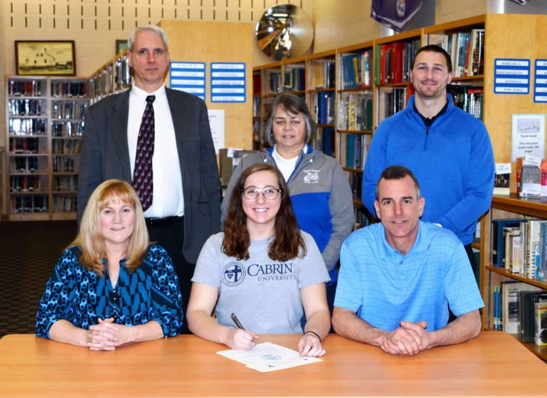 Central Mountain High School swimmer Rachel Marek (bottom center) signs her letter of intent to continue her student-athlete career at Cabrini University. Sitting (L-R) Raelene Marek (mom), Rachel Marek, Joseph Marek (father). Standing (L-R) Jim Merinar (coach), Carol Matheney (assistant coach), George Bidwell (Central Mountain High School Athletic Director).Marek has been accepted into the Cabrini honors program and will be majoring in Marketing with a minor in Psychology. (The Express/Phil Mapstone)