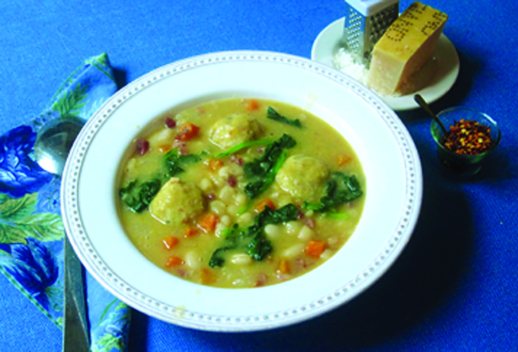 This Jan. 26, 2018 photo shows white bean soup with bread dumplings in New York. This dish is from a recipe by Sara Moulton. (Sara Moulton via AP)