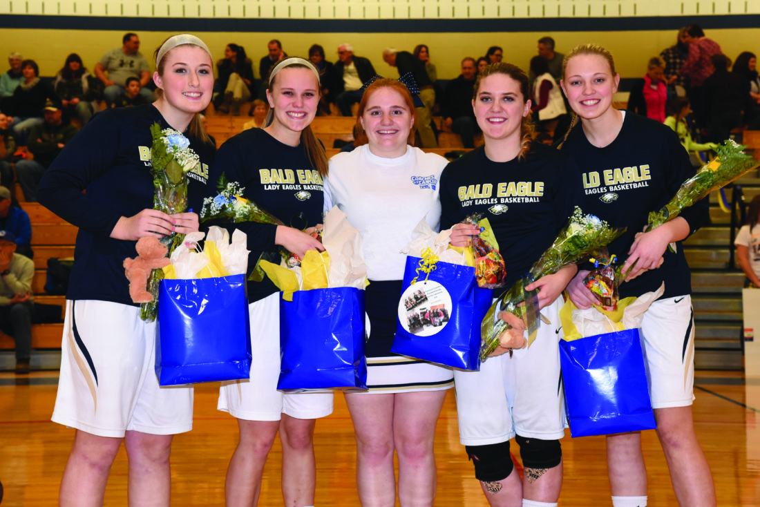 Bald Eagle Area High School Girl's Basketball seniors (Alexis Bucha, Mariah Veneziano, Cheer Oriana Conaway, Madison Watkins and Morgan Chambers) pose for a photo during a senior ceremony before a basketball game against Bellefonte. (The Express/Tim Weight)