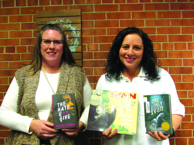 EMMA GOSALVEZ/THE EXPRESS Brenda Rogers, left, and Jackie Wynkoop showcase this year's books for Bellefonte READS.