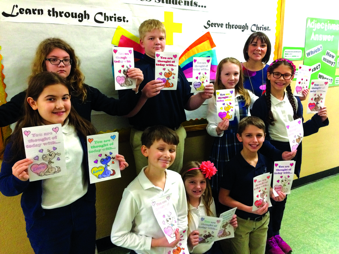 Lock Haven Catholic School students participated in a community service project to brighten the day for many local residents who are homebound due to illness or injury. They recently colored and decorated Valentine's Day cards for all the patients of Community Nursing Service of Clinton County. The nurses will deliver the cards, to fill the patients' day with smiles. From left are students Brayden Spedding, Chloe Confer, Nick Piergallini, Reese Walizer, Eve MacIntyre, Ethan Coakley, Shannon Hanna, Vivian Wilt and Community Nursing Service community liaison Kira Rosamilia.