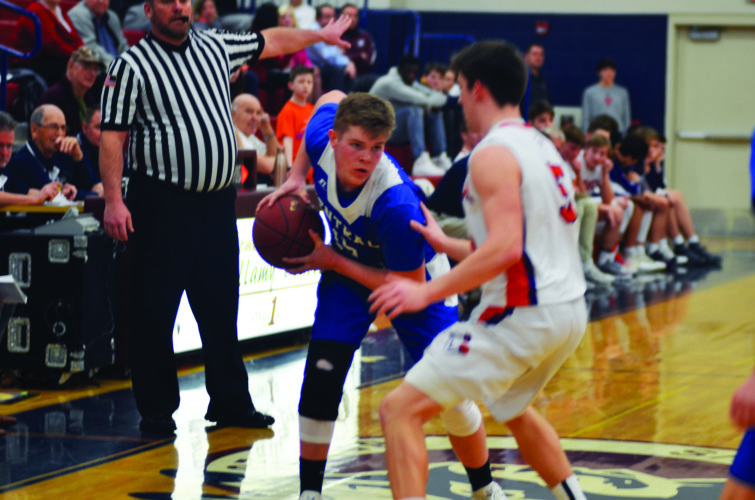Central Mountain High School's Trevor Hanna prepares for a shot while being guarded by Danville High School's Shane Kozick. Hanna recorded 12 points in Central Mountain's 50-48 loss to Danville in the PHAC semifinals. (The Express/Shareik Flowers)