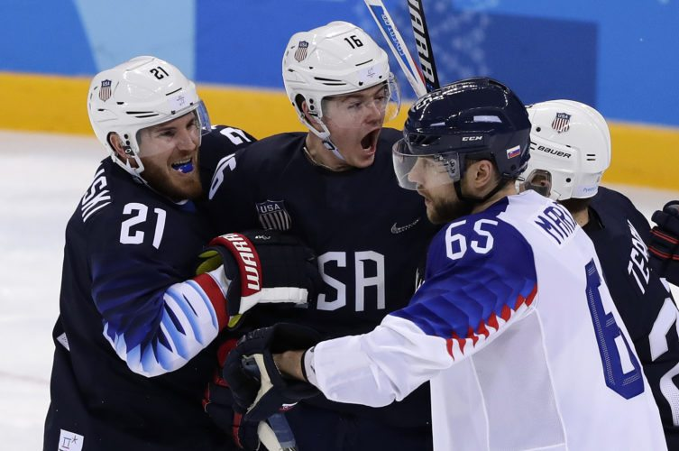 Ryan Donato (16), of the United States, celebrates his goal with James Wisniewski (21) and Troy Terry (23) during the third period of the preliminary round of the men's hockey game against Slovakia at the 2018 Winter Olympics in Gangneung, South Korea, Friday, Feb. 16, 2018. (AP Photo/Frank Franklin II)