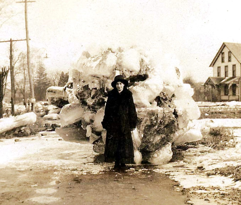 PHOTOS PROVIDED BY THE ROSS LIBRARY At top, left people walking down East Main Street. Right, unidentified woman stands in front of a huge ice chunk. Above, top left, car owned by Clarence Dunn flooded on Bellefonte Aveune and Church Street. At right, residents walk on ice chunks on Henderson Street. Center, large ice chunks piled on East Water Street.