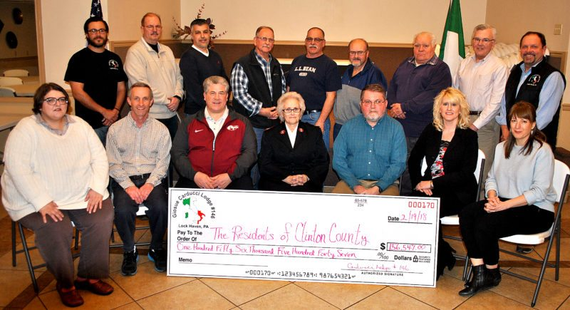 BOB ROLLEY/THE EXPRESS Marking a record year of gifting by the Giosue Carducci Lodge 146, Sons and Daughters of Italy are both lodge board members and recipients. Shown this past week are, from left in front, Tammy Garrison of Ross Library; Scott Moore of Clinton County Community Connections; Tom Gioglio of the Lock Haven YMCA; Maj. Sharon Cupp of the Salvation Army;  Tim Reeves of Bucktail Medical Center; Lisa Bangson of the Infant Development Program, and Calra Fisher of the Central Pennsylvania Food Bank. In back, from left, are lodge board members Nick Santonico, Craig Miller, Anthony Bognanni, Perry Walker, Tom Walker, Keith Duvall, Dennis Caprio, Steve Acquino and Dan Vilello.