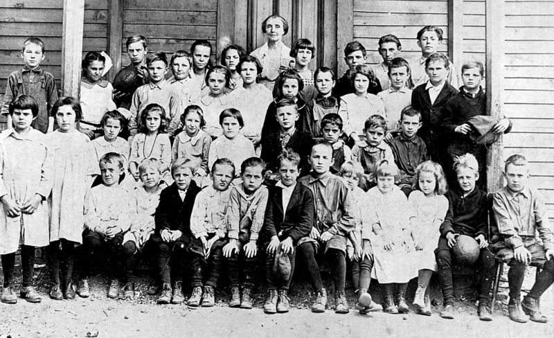 EXPRESS ARCHIVES These Dunnstown School students of 1922-23 are, from left, in front: Edith (Bunny) Probst and a Hecht girl, both standing; and seated: Charles Smith, Scorchy Munro, Lawrence Peddigree, Charles Hake, Wayne Myers, Robert Rote (with cap), Harris Reynolds, Clair Haskins, Marian McCloskey, Bertha Motter, Toner Haskins (with football) and Clair Richey; in the second row: Jean McSherry, a Motter girl, Edith Munro, a Hecht child, a Peddigree boy, Paul Probst, Woodrow (Jigs) Probst, Walton Richey and Bob (Mike) Johnson (with cap); in the third row: Frederick Mader, N. Smith, Dick McCloskey, Oscar Hake, Helen Myers, Lillian Smith, Madeline Crider, Edgar Mader, Sara Moran, a Motter boy and a Hecht boy; and in back: Cad Johnson (with football), a Peddigree child, an unknown girl, teacher Elizabeth McCloskey, Bernice Moran, Charles W. Rote, Nig Smith and Lester Shoemaker.