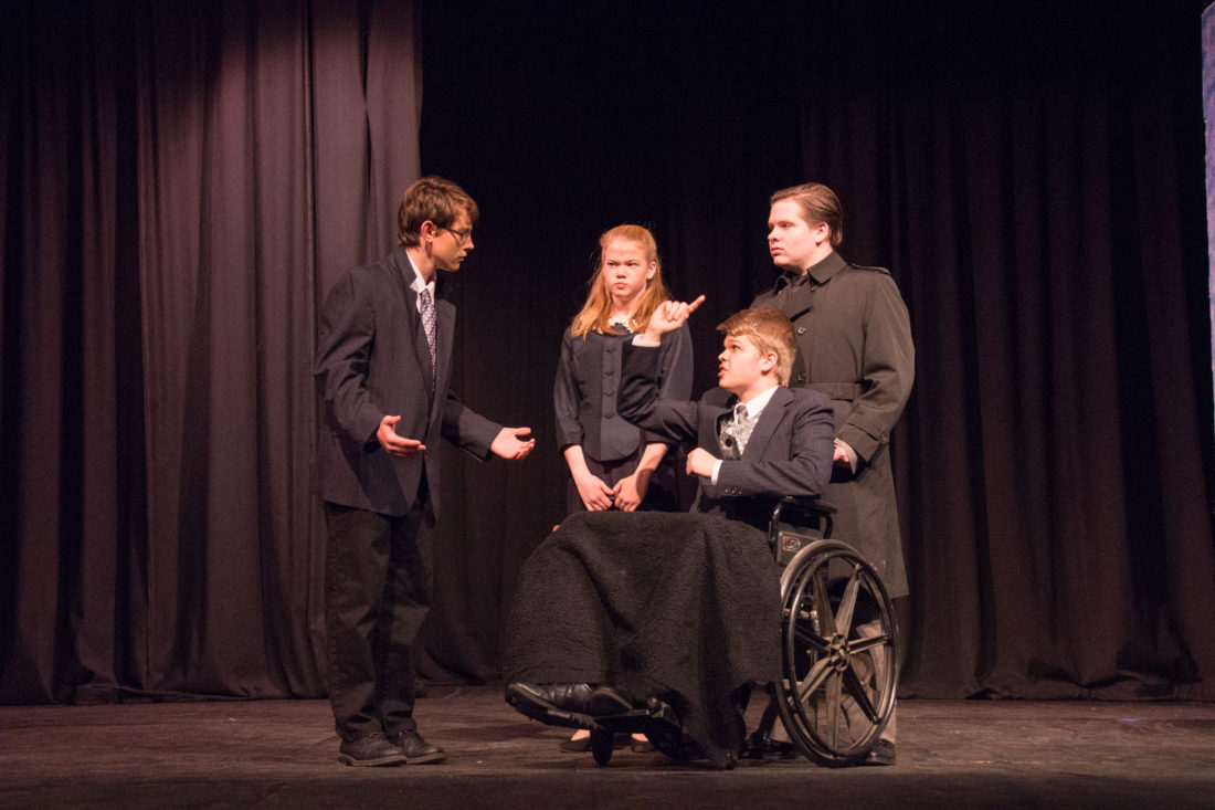 "Left to right: Alex Bauerbach, as George Bailey; Sydney Gammon as Potter's secretary; Maxwell Schafer, as Mr. Potter; and Davey Thrasher, as Potter's goon, in a scene from ""It's a Wonderful Life."""