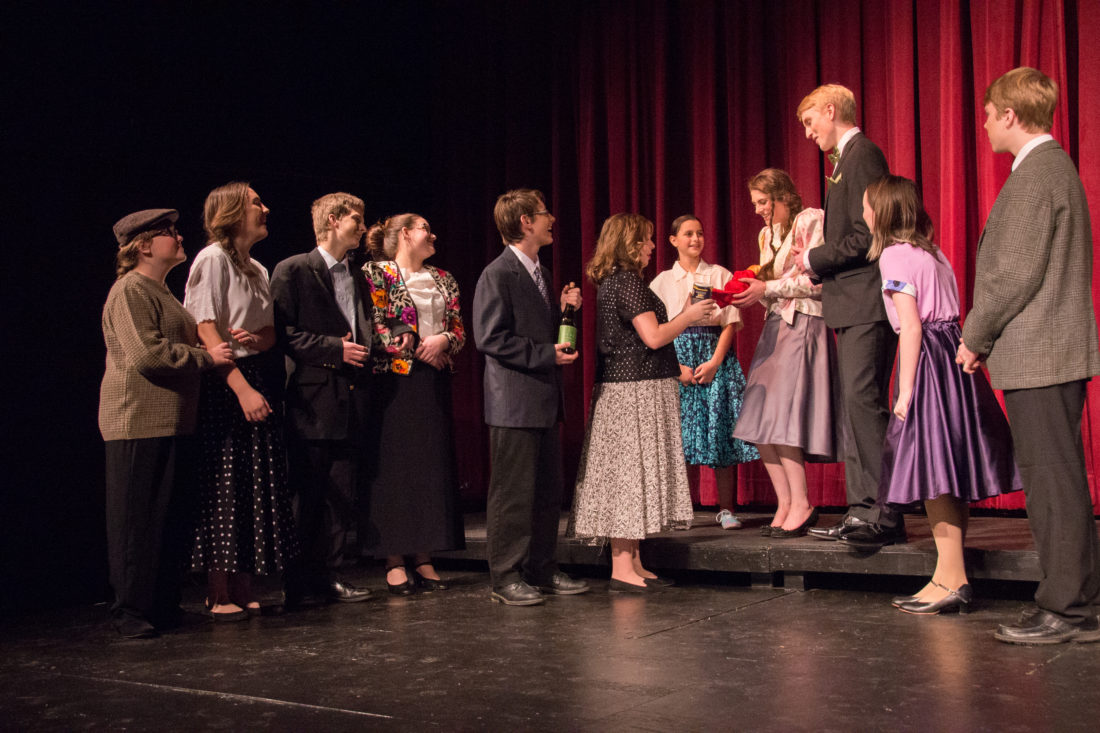 Townspeople, played by members of the MOVP Youth Theater, congratulate George and Mary Bailey on their marriage.