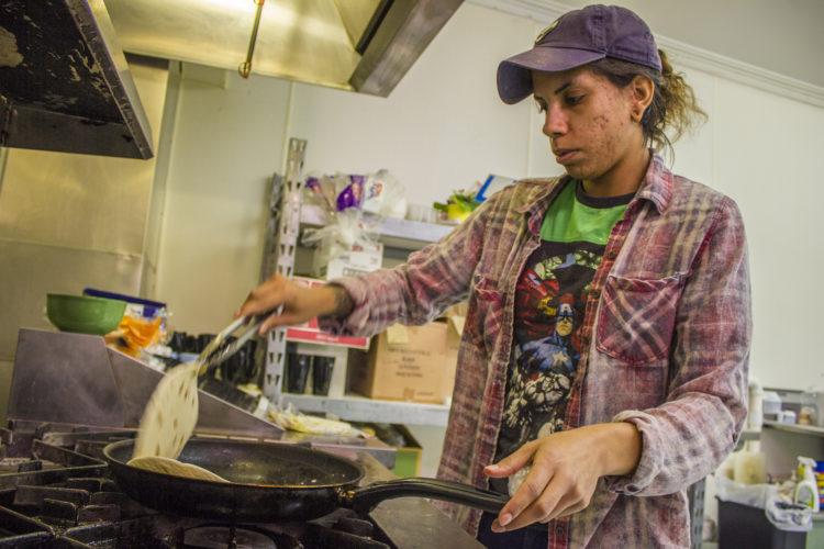JANELLE PATTERSON   The Marietta Times Co-owner Chelsea Lancaster prepares a dish Thursday at Nacho Average Taco, 114 Putnam St.