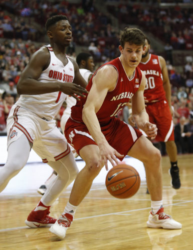 Nebraska forward Michael Jacobson, right, works against Ohio State forward Jae'Sean Tate during an NCAA college basketball game Saturday in Columbus, Ohio. Nebraska won 58-57 (AP Photo).
