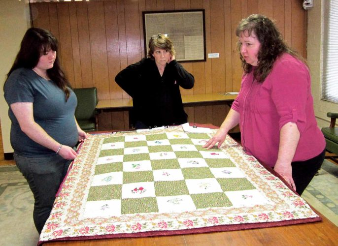 WAYNE TOWNER   Special to the Times Quilting judges Amy Pabst, from left, Sue Papouschek and Barbara Jones review submitted quilts in preparation for the opening of the 13th annual Mid-Ohio Valley Heritage Quilt Show at the Blennerhassett Museum of Regional History in Parkersburg. This year's exhibit opens Saturday and runs through March 19.