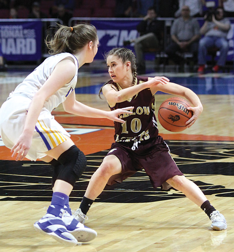 Williamstown senior point guard Ashley Morris, pictured here in the Class A state championship game against Huntington St. Joe, earned first-team all-state honors for the third consecutive season. Photo by Michael Uhl.