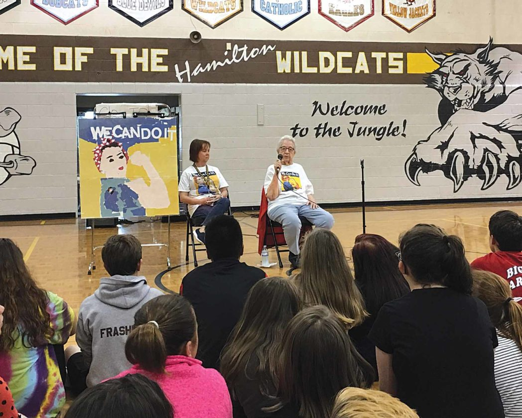 "Michael Erb   Special to the Times Hamilton Middle School teacher Jennifer Furner, left, listens along with students to stories told by Marietta resident Neva Rees, who worked as a ""Rosie the Riveter"" during World War II."