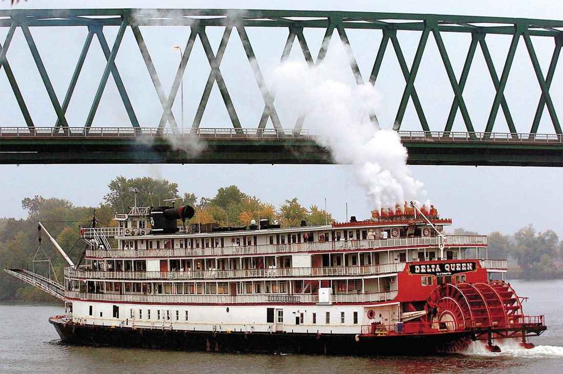 Times file photo The Delta Queen steams beneath the Williamstown Bridge following a visit to Marietta in 2005.