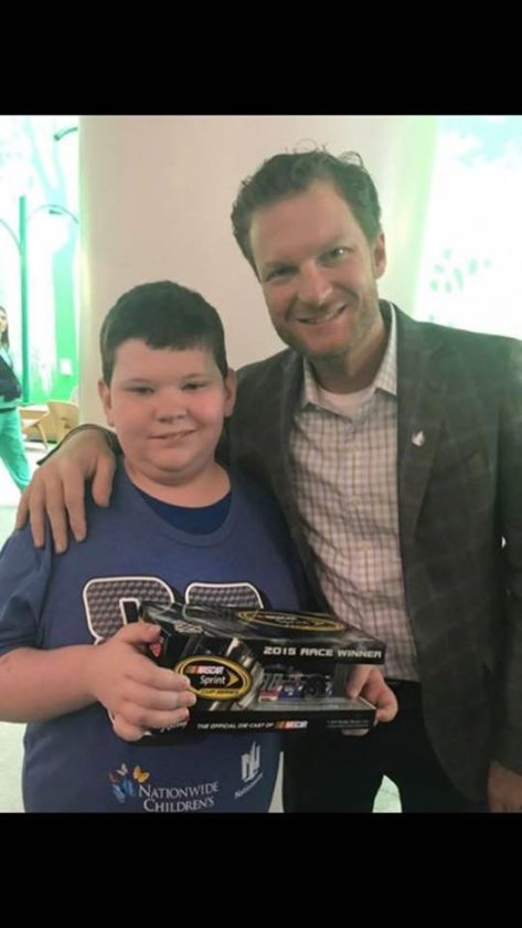 NASCAR driver Dale Earnhardt Jr., right, smiles with Marietta resident Tristen Cooper, 10, at Nationwide Children's Hospital in Columbus last month.  Photo  submitted by April Cooper