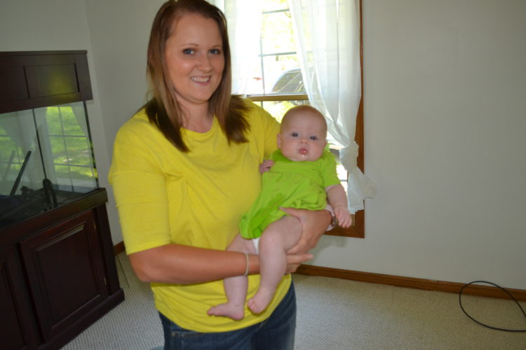 ERIN O'NEILL   The Marietta Times Mariah Carper holds her daughter Alice at their new Waterford home.