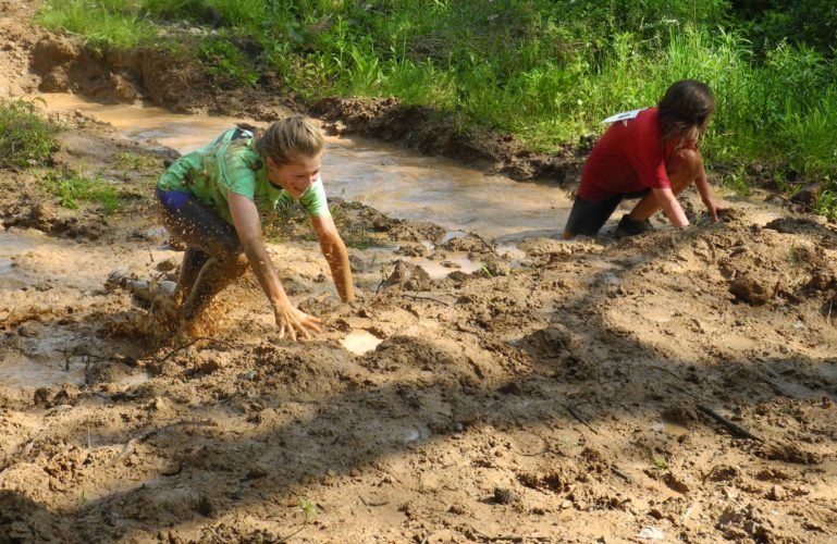 JEFFREY SAULTON   Special to the Times Jade Poling, left, and Ryan Province, right, make it through the mud.