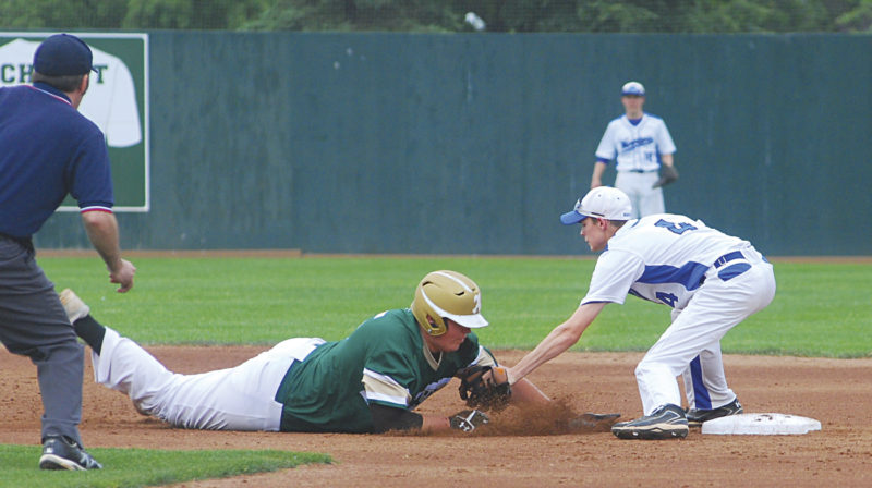 Athens' Brody Rodgers, left, gets picked off second base as Warren's Tyler Tanner applies the tag during the third inning of Wednesday's Division II district final baseball game at Ohio University's Bob Wren Stadium in Athens. Photo by Jordan Holland.