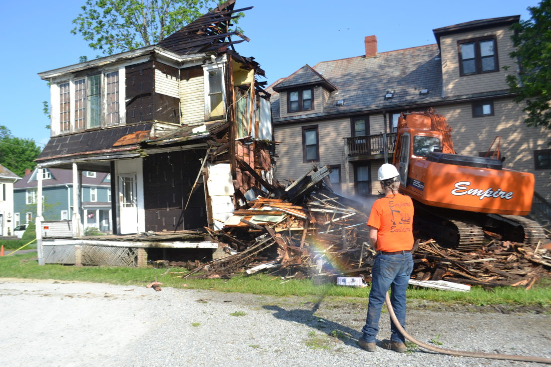 PEYTON NEELY   The Marietta Times Workers with Ken Strahler Masonry demolish the house at 506 Front St. early Thursday morning.