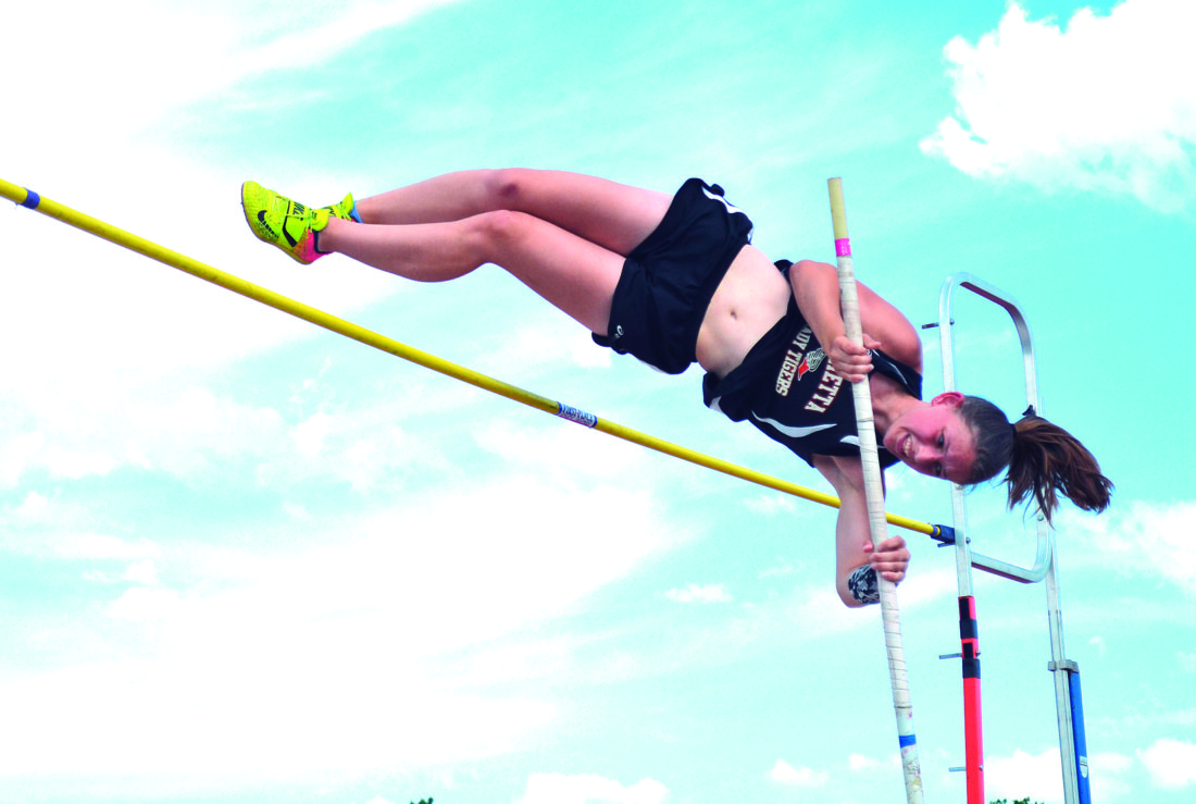 RON JOHNSTON The Marietta Times Marietta High's Baylee Brown competes in the pole vault at Thursday's Division I East/Southeast District track meet at Don Drumm Stadium. Brown finished first in the event.