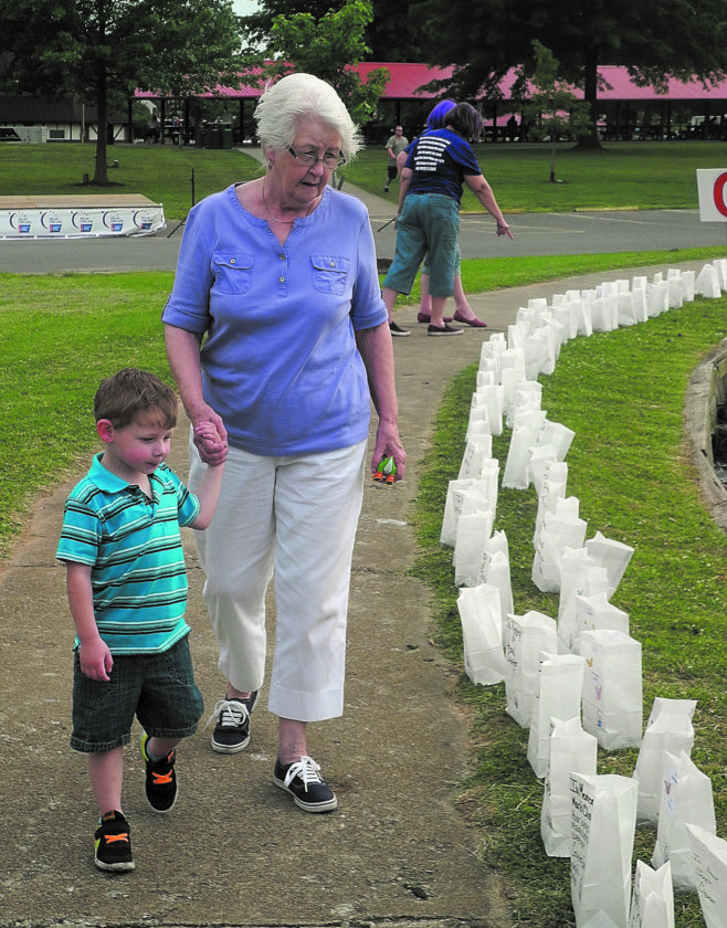 JEFFREY SAULTON  Special to the Times Taking a look at the luminarias for Friday's opening of the 2017 Wood County Relay for Life are Linda Craig, right, and Derek Parsons, left, of Parkersburg.
