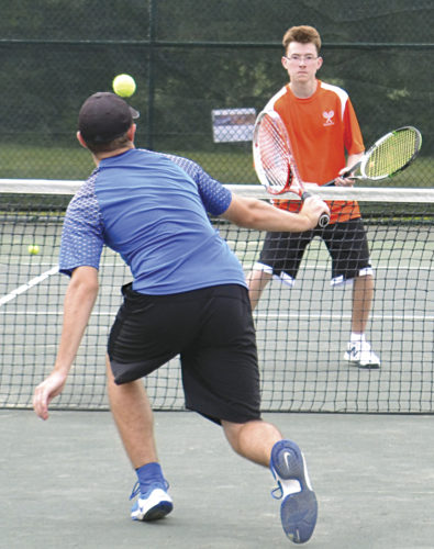 Marietta High's Mason Cline competes during SE District doubles competition in the second round at the Ohio Unversity Golf & Tennis Center Saturday. He and teammate Mason Cline won a first-round match but bowed out in the second round. Photo by Ron Johnston.