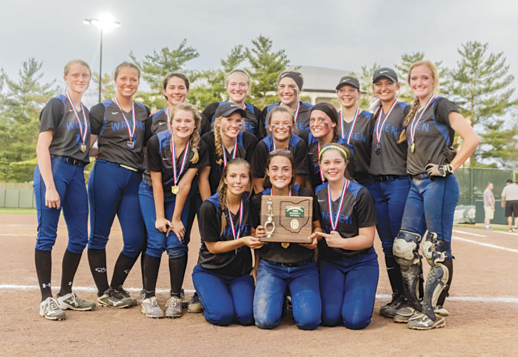 The Warren softball girls celebrate their victory at the district tournament final earlier this year.
