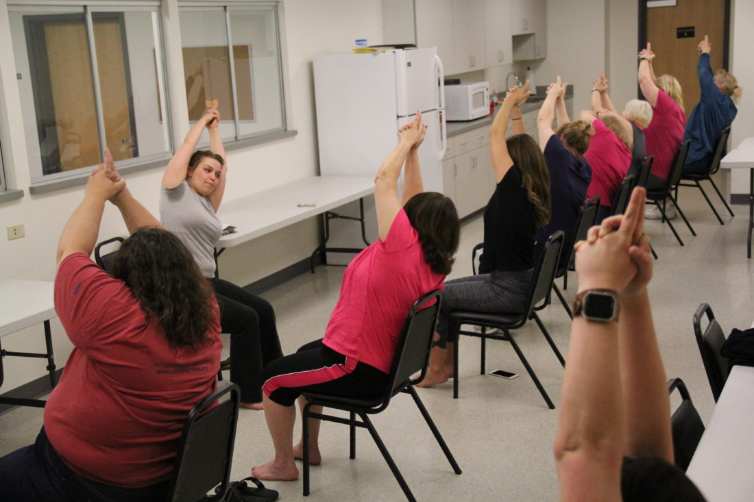 JANELLE PATTERSON   The Marietta Times R.S.V.P Americorps Volunteer Stacey Steed teaches chair yoga to the Prevent T2 diabetes prevention class with the Washington County Health Department Monday.