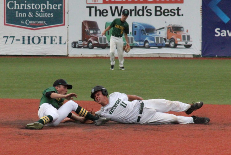 Photo courtesy of Alex Hawley Waterford's Isaac Huffman, right, dives back to second base during a Division IV district final baseball game against Eastern last week in Chillicothe.