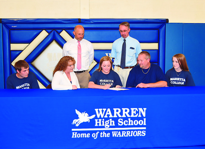 Courtesy photo Warren High senior Stephanie Sydenstricker (center, front row), committed to continuing her track and field career at the collegiate level for Marietta College. She plans to major in early childhood education.