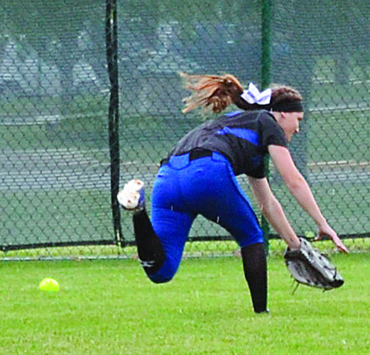 RON JOHNSTON The Marietta Times Warrem outfielder Emilie Mallett makes a diving attempt on a ball during Wednesday's Division II regional semifinal softball game against Lakewood in Pickerington.