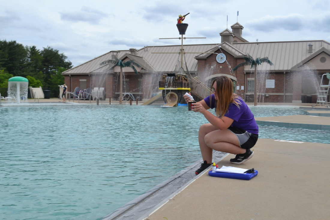 PEYTON NEELY   The Marietta Times Assistant manager Trista Wick checks the chemicals in the pool of the Marietta Aquatic Center  on Tuesday.