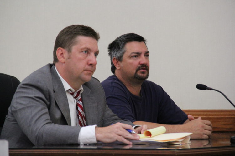 JANELLE PATTERSON   The Marietta Times John Clark Nelson III, (right) 43, of 2396 Woodruff Road, Vincent, appears in Washington County Common Pleas Court for sentencing Thursday with his attorney Eric Fowler.