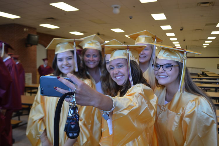 PEYTON NEELY   The Marietta Times A group of girls pose as Williamstown senior Adesa Williams, center, takes a picture with her phone before they got their diplomas at Williamstown's graduation ceremony on Thursday.