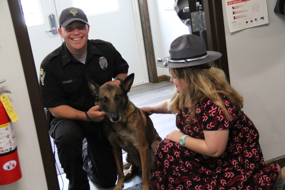JANELLE PATTERSON   The Marietta Times Honorary Trooper Hallie Witte, 9, of Little Hocking, reconnects with Bart, and his K-9 handler Trooper Brian Stackey Friday at the Marietta Post of the Ohio State Highway Patrol.