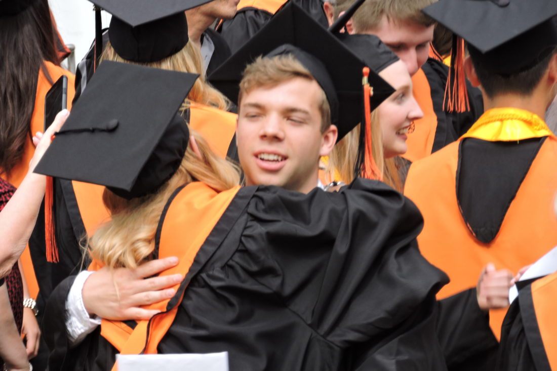 SAM SHAWVER   The Marietta Times Marietta High School grad Nathan Westfall embraces classmate Luanna Wriston following Sunday's MHS commencement exercises at the Marietta College Dyson-Baudo Recreation Center.