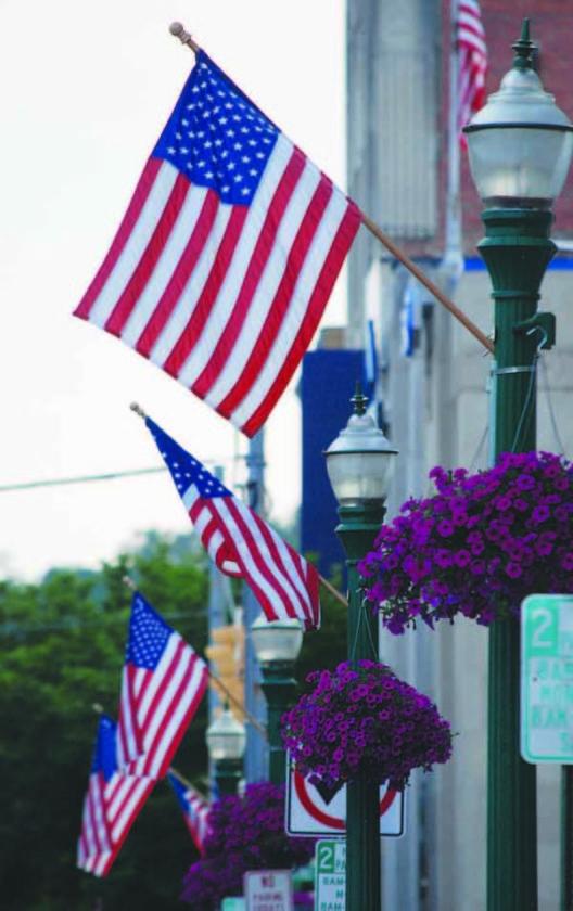 Flags fly along Putnam Street.