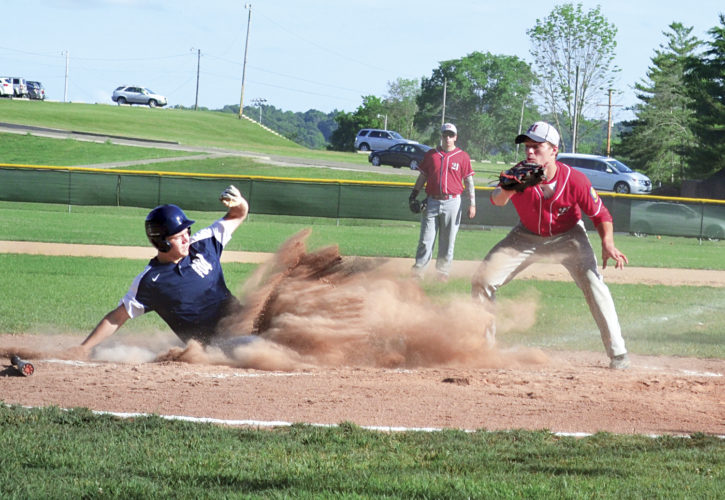Ron Johnston, THE MARIETTA TIMES  Marietta Post 64's Zach Cunningham slides safely into home during second inning action Wednesday night at Athens High.