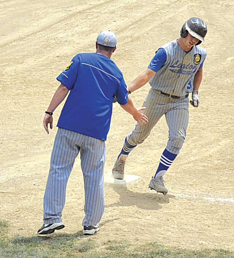 Beverly/Lowell's Konnor Roberts, right, is congratulated by third-base coach Tyler Engle after hitting a solo home run in Game 1 at Fort Frye High Sunday afternoon. BevLow dropped a 10-8 decision to Tuscarawas Post 205 in the first game. Photo by Ron Johnston.
