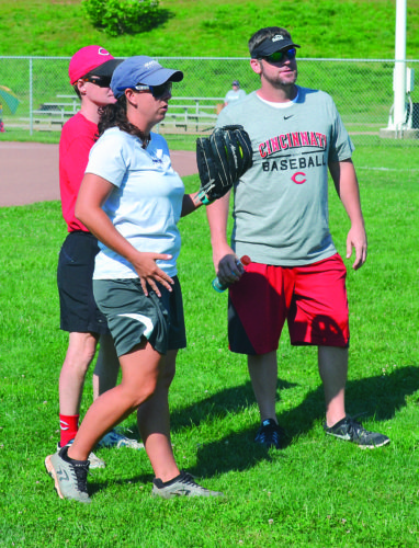RON JOHNSTON The Marietta Times Instructors Jenn Castle and Scott Williamson chat at the 24th annual Cincinnati Reds Legends Youth Baseball/Softball Clinic at the Vienna, West Virginia, Recreation Sports Complex at Jackson Park Wednesday morning.