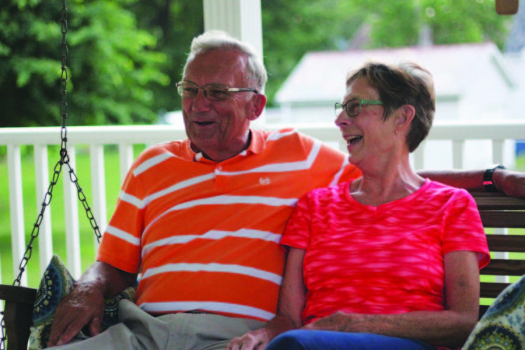 JANELLE PATTERSON The Marietta Times Roger and Shirley Doak laugh on their front porch swing in Waterford Thursday evening.