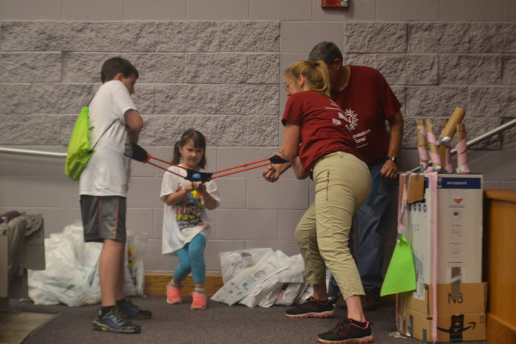 PEYTON NEELY   The Marietta Times Sky Elliott, 5, pulls back the human sling-shot at Washington State Community College during Camp Invention on Friday.