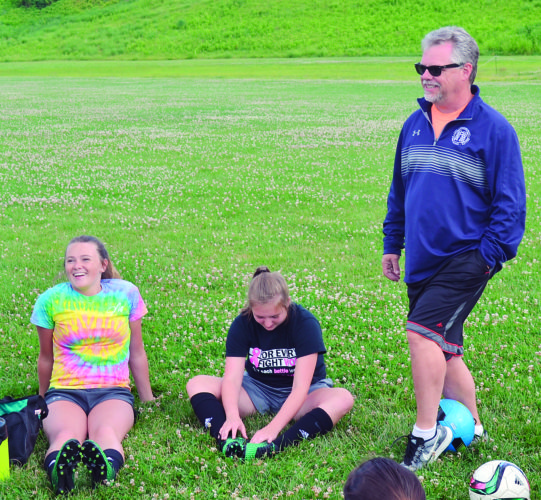 RON JOHNSTON The Marietta Times Dave Pickering, who was recently named head coach of the Williamstown High girls soccer program, speaks to players during a summer training session Monday.